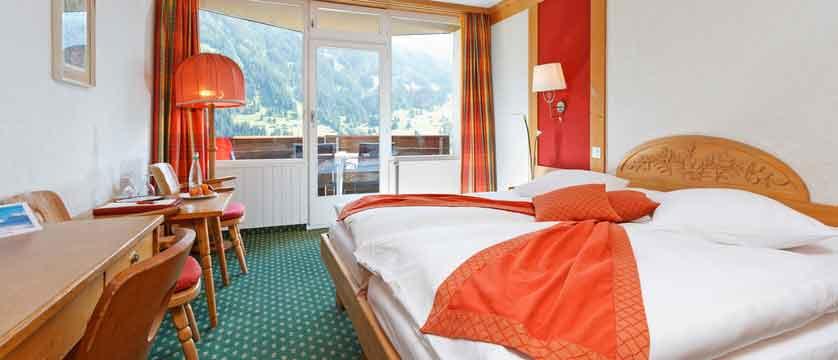 Hotel Derby, Grindelwald, Bernese Oberland, Switzerland - superior bed.jpg